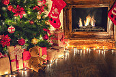 Wrapped presents under the Christmas tree in a cozy festive atmosphere