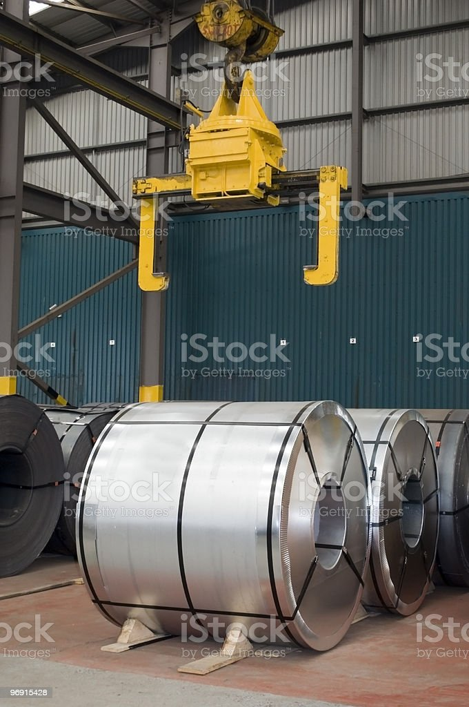 Wrapped & Unwrapped Steel Coils in Warehouse royalty-free stock photo