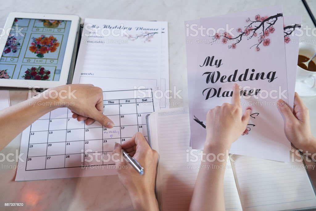 Wrapped up in Planning Wedding Day stock photo