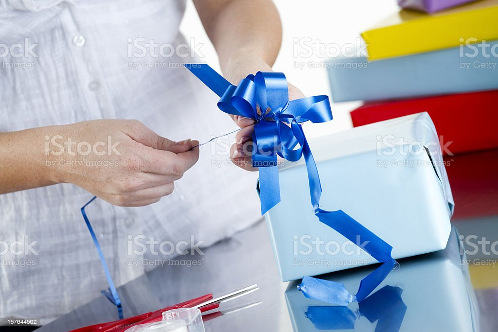 Wrapping a Gift stock photo