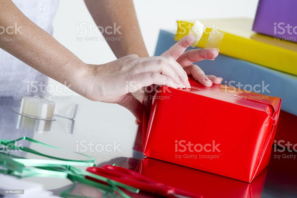 Wrapping a Gift royalty-free stock photo