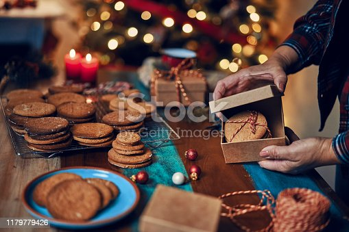 Wrapping and decorating Christmas presents for sending homemade cookies as a gift for Christmas.
