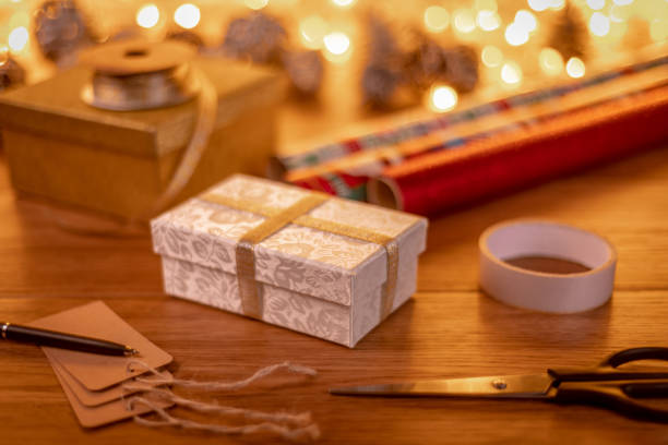 wrapping christmas presents and writing gift tags - christmas stock photos and pictures