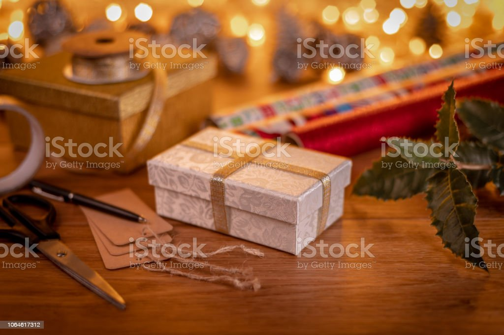 Wrapping Christmas Presents and writing gift tags stock photo
