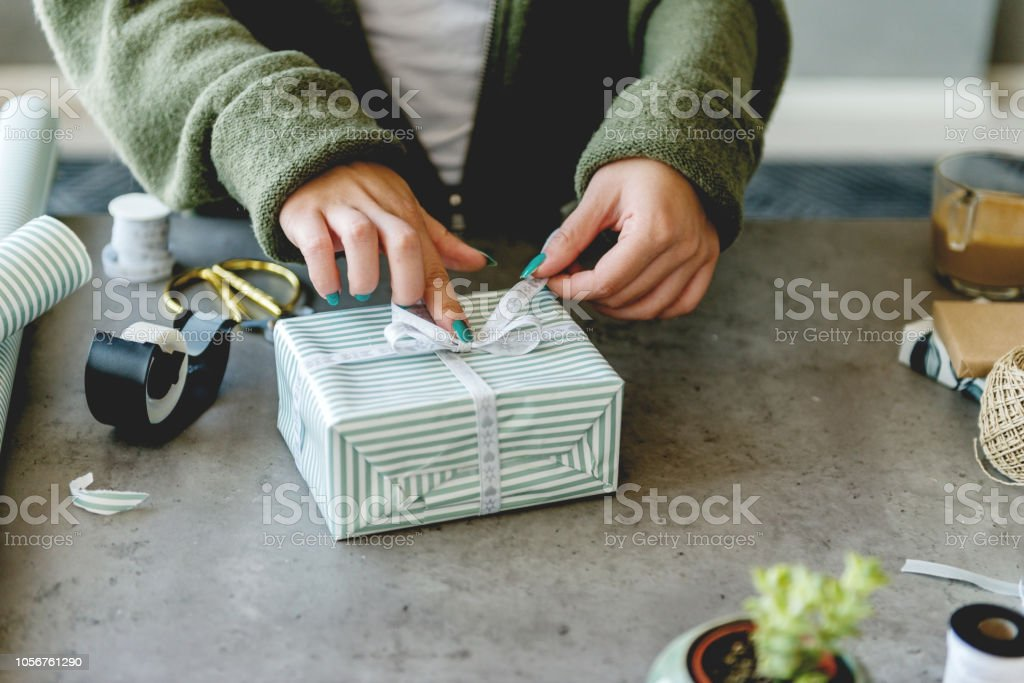 Wrapping Christmas presents stock photo