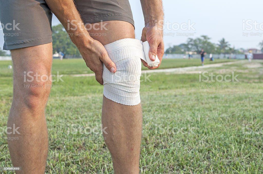 Wrapping knee injury stock photo