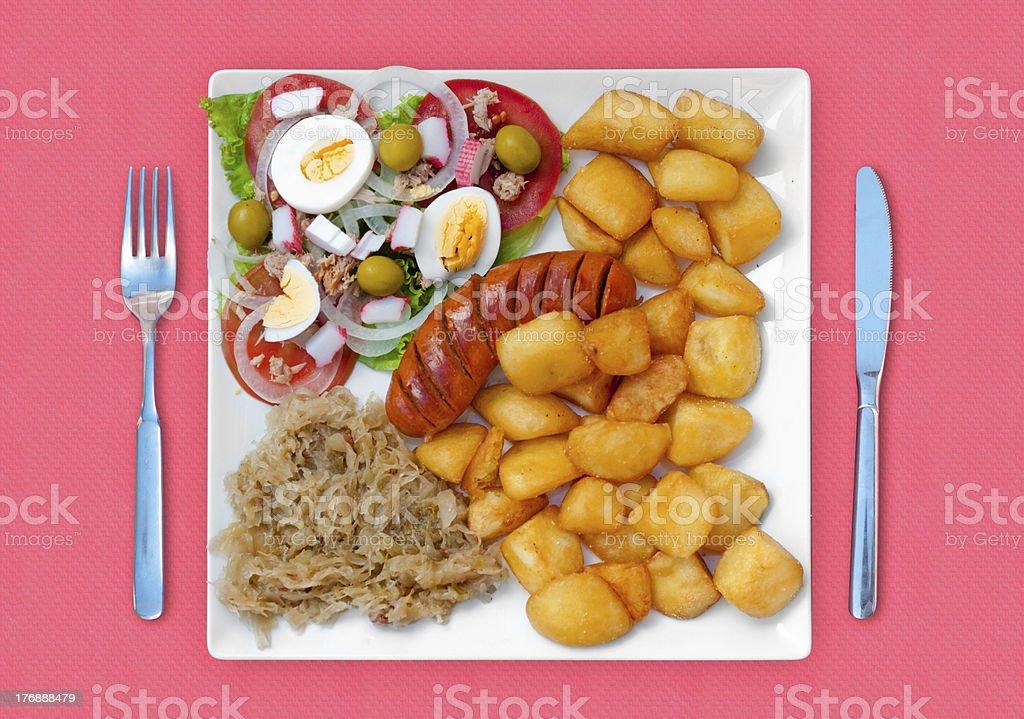 wratwurst with sauerkraut salad and potatoes royalty-free stock photo