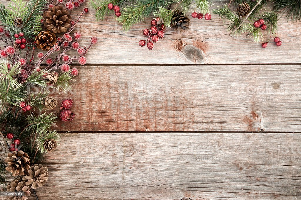 Wreath Garland Pine Border on a Rustic Wood Blackboard Background stock photo