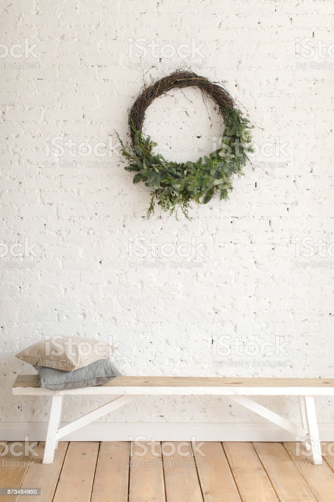 Wreath hanging over bench stock photo