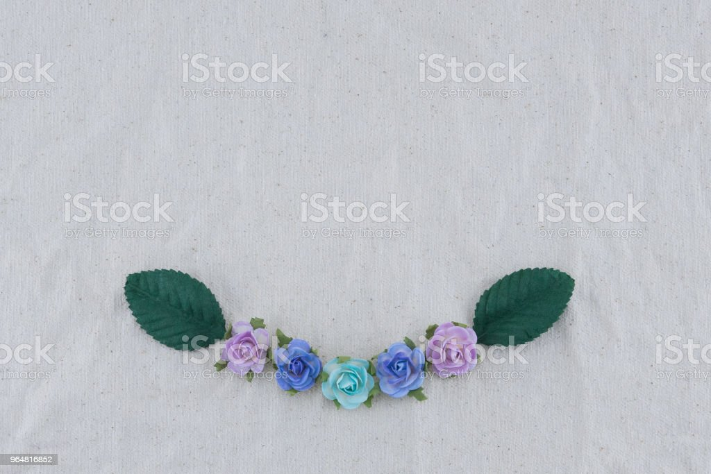 Wreath made from blue tone rose paper flowers and green leaves royalty-free stock photo
