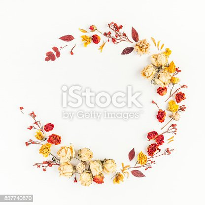 istock Wreath made of autumn leaves, flowers. Flat lay, top view 837740870