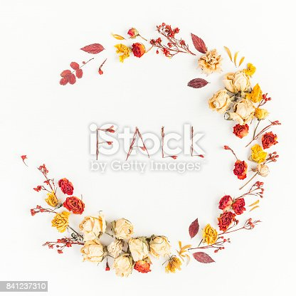 istock Wreath made of autumn leaves flowers. Flat lay, top view 841237310