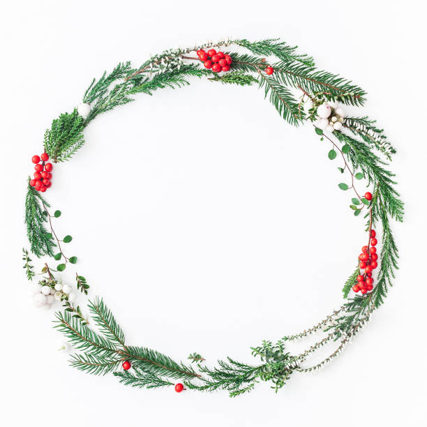 Wreath made of christmas tree branches. Flat lay, top view stock photo