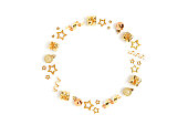 istock Wreath made of gold Christmas toys and confetti. 1286112842