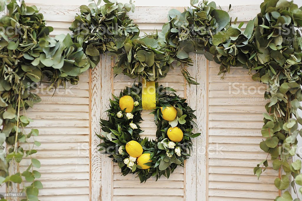 Wreath made of laurel leaves, roses and lemons stock photo