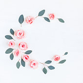 istock Wreath made of pink rose flowers and eucalyptus leaves 689777954
