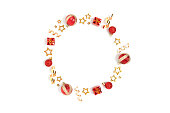 istock Wreath made of red Christmas toys and gold confetti. 1286113814