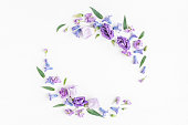 istock Wreath made of various colorful flowers. Flat lay, top view 664931688