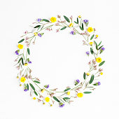 istock Wreath made of yellow flowers and eucalyptus leaves. Flat lay 687174316
