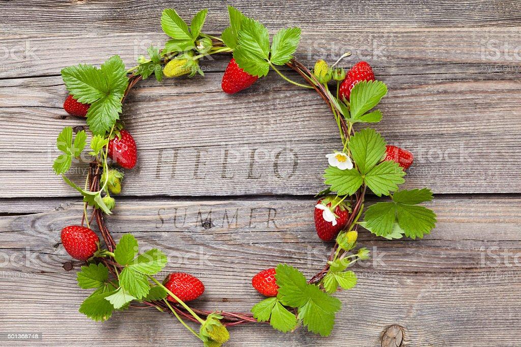 Wreath of fresh strawberries. stock photo
