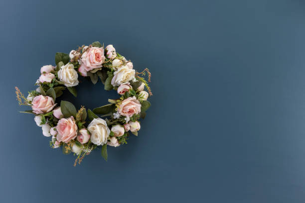 Wreath of pink and white roses on a plain blue background copy space picture id1199083542?b=1&k=6&m=1199083542&s=612x612&w=0&h=pix4xjx99vflkp1cg4x7tiengs1fxfzzb6luhk7cz7i=