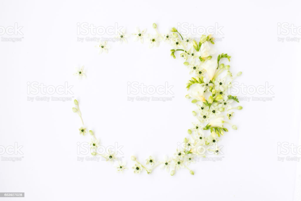Wreath of spring flower on white background. stock photo