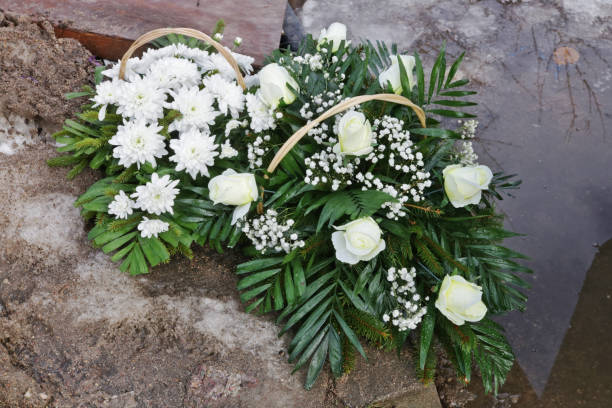 Wreath of white roses and chrysanthemums in the cemetery picture id1132225588?b=1&k=6&m=1132225588&s=612x612&w=0&h=u1gyxhiftoiptjfiuc7ejturlnde5swnwwk9  1sb m=