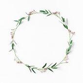 istock Wreath, pink flowers, eucalyptus leaves. Flat lay, top view 699795494