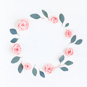 istock Wreath, pink rose flowers, eucalyptus leaves. Flat lay, top view 699781820