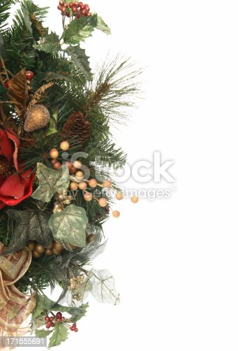 A Christmas decoration isolated on the side of a white background perfect for copy space.