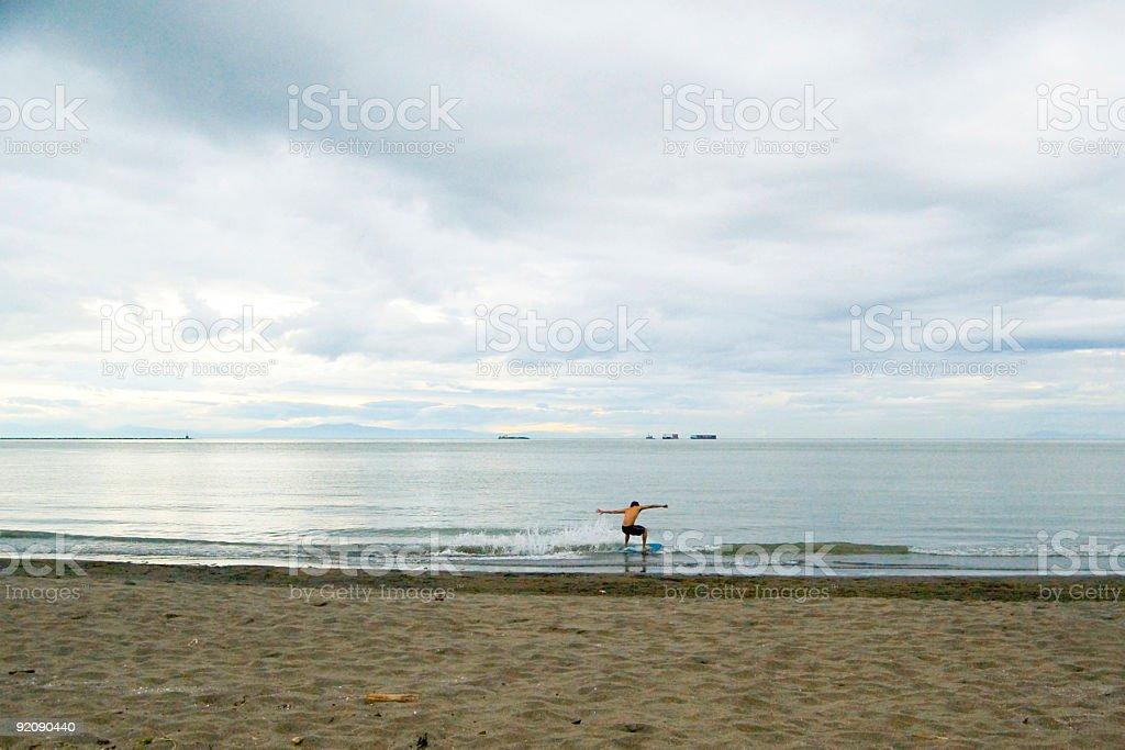 Wreck Beach Skimboarding (wide) stock photo