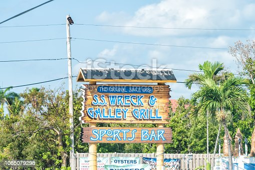 Marathon, USA - May 1, 2018: SS Wreck & Galley Grill restaurant, sports oyster bar sign serving steak, frog legs by overseas highway, freeway road, street in Florida Grassy key island city