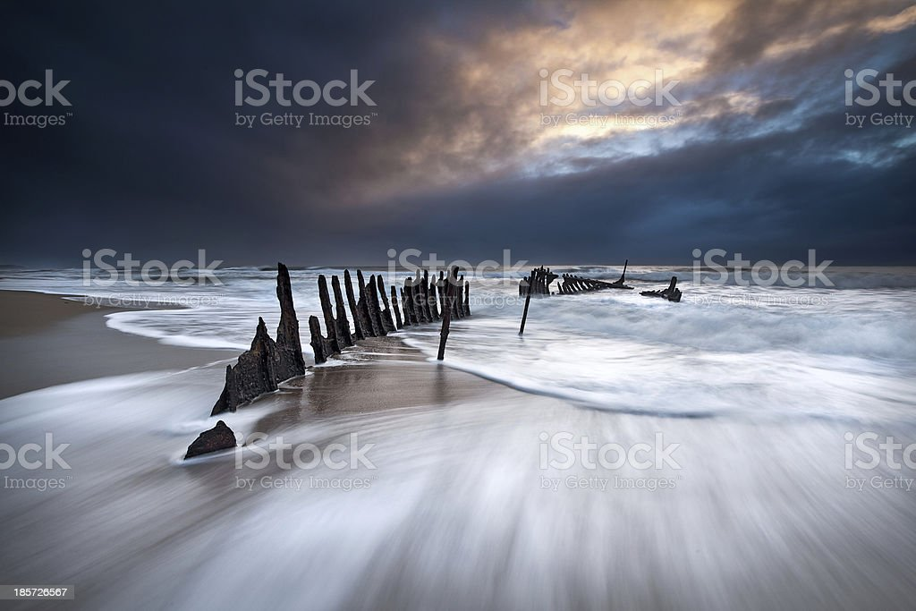 Wreck of ship on a beach royalty-free stock photo