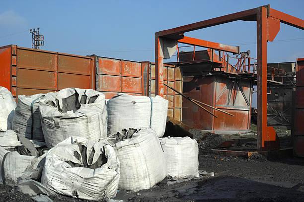 Wreck Yard And Stone Sack stock photo