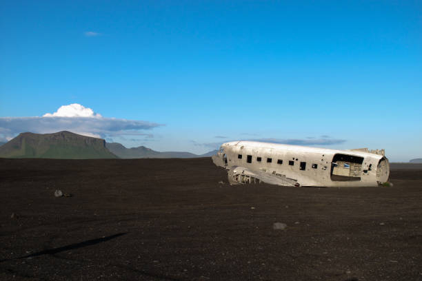 Wreckage of crashed airplane in 1973 Douglas R4D Dakota DC-3 C 117 of the US Navy in Iceland at Solheimasandur beach. Wreckage of crashed airplane in 1973 Douglas R4D Dakota DC-3 C 117 of the US Navy in Iceland at Solheimasandur beach. sólheimasandur stock pictures, royalty-free photos & images
