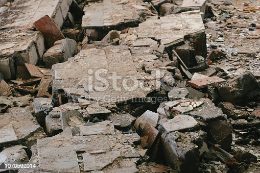 istock Wreckage of the destroyed building and crash. 1070592014