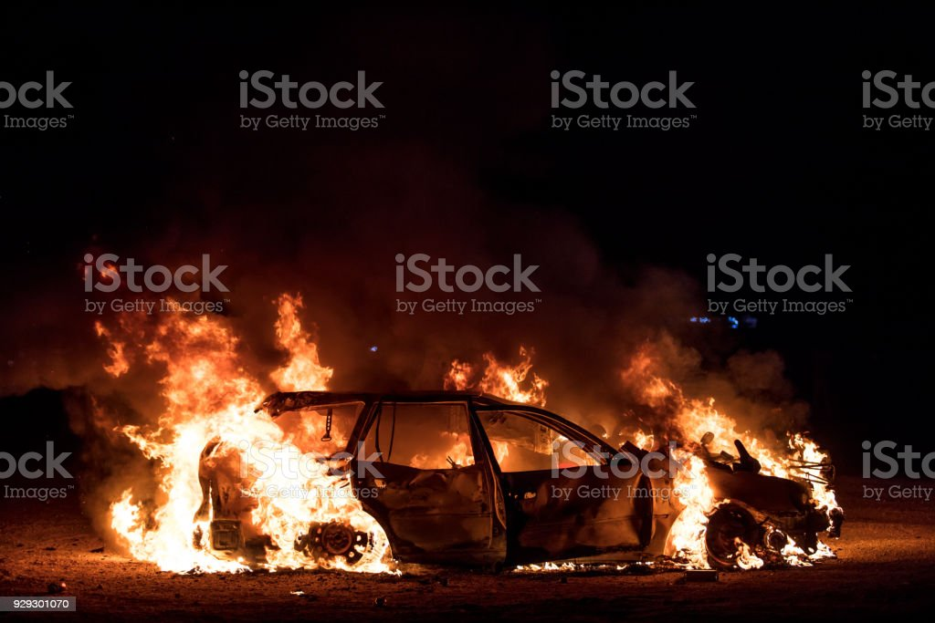 Wrecked Car Engulfed in Flames stock photo