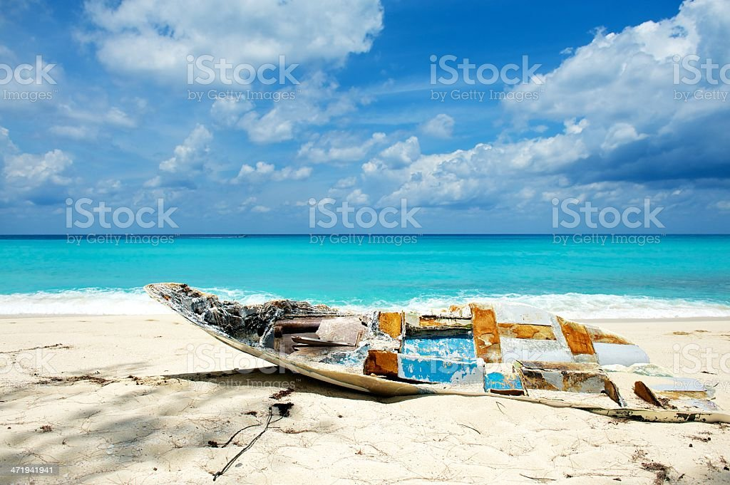 Wrecked fishing boat on the beach stock photo