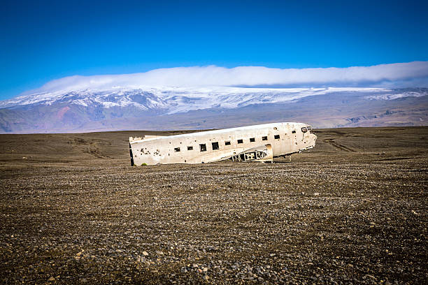"""Wrecked plane in Iceland United States Navy airplane (C-47 SkyTrain also known as """"Dakota"""") was forced to land on Sólheimasandur's black sandy beach in the south of  Iceland on the Saturday of Nov 24, 1973. The crew survived the landing and the airplane's remains are pictured here at the crash site. sólheimasandur stock pictures, royalty-free photos & images"""