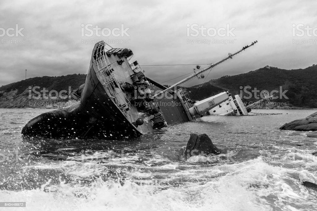 Wrecked ship along the rocky coast (Black and white) stock photo