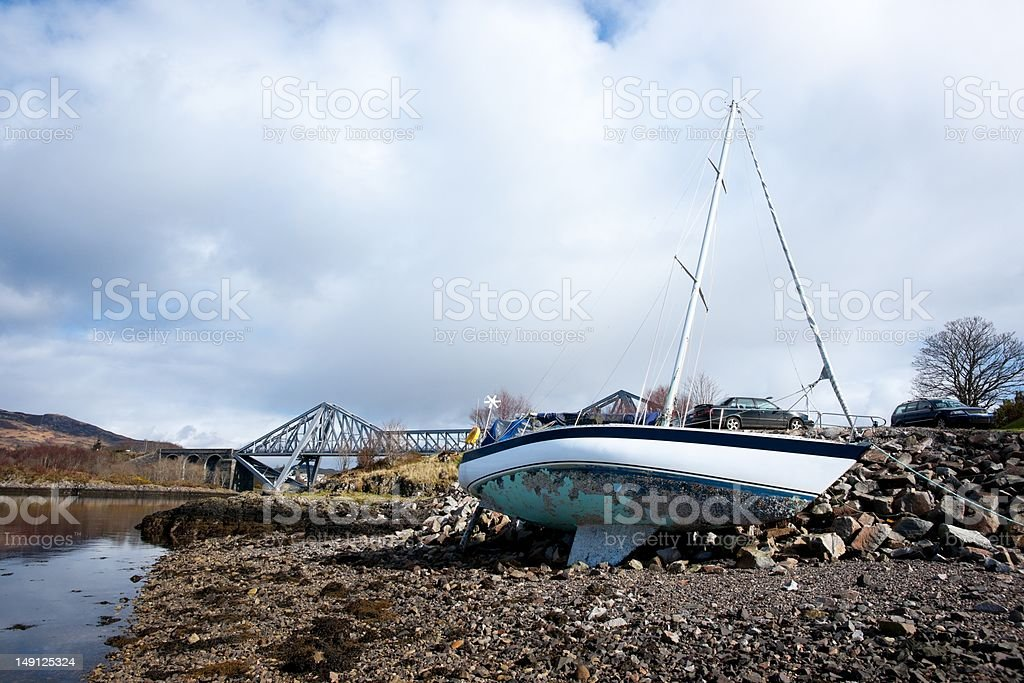 Wrecked yacht on shore royalty-free stock photo