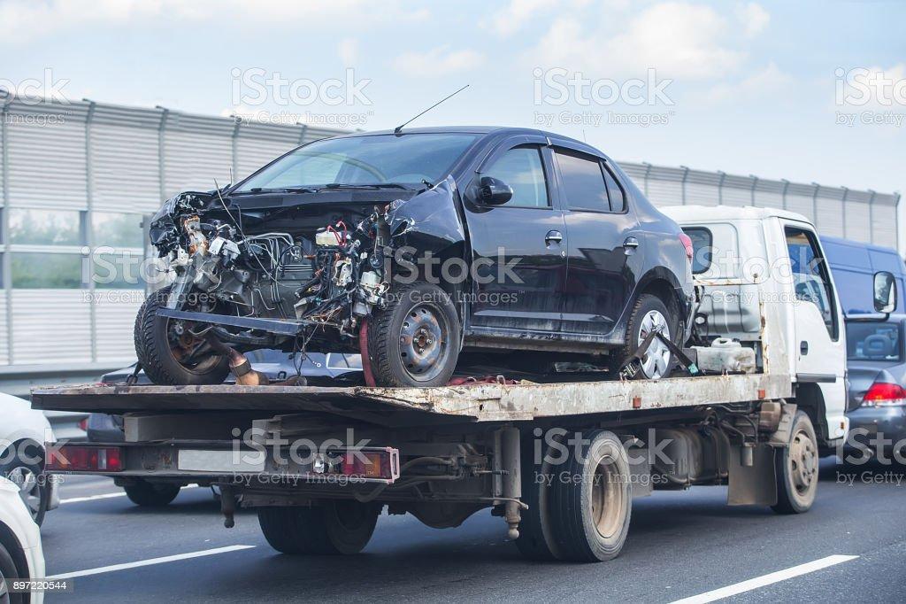 wrecker transports broken car stock photo