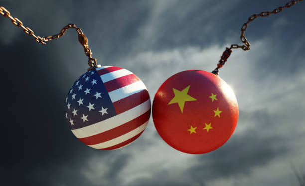 Wrecking Balls Textured with American and Chinese Flags Over Dark Stormy Sky stock photo