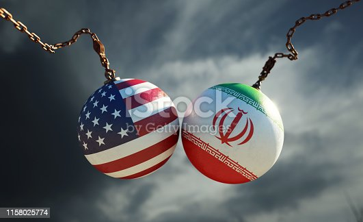 Wrecking balls textured with American and Iranian flags over dark stormy sky. Horizontal composition with copy space and selective focus. Dispute concept.