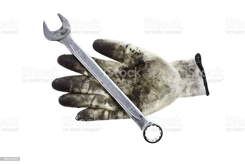 Wrench and a glove royalty-free stock photo