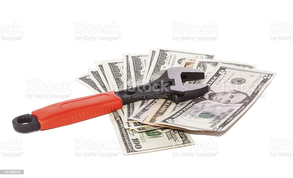 Wrench and bills of dollars stock photo