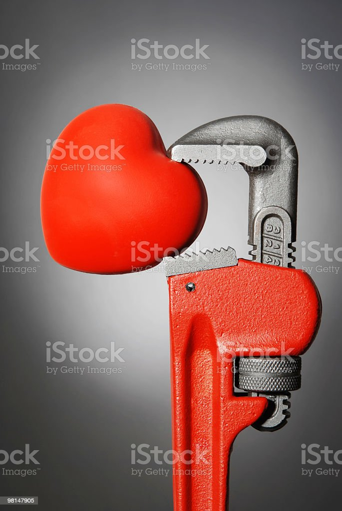 Wrench Holding Heart royalty-free stock photo