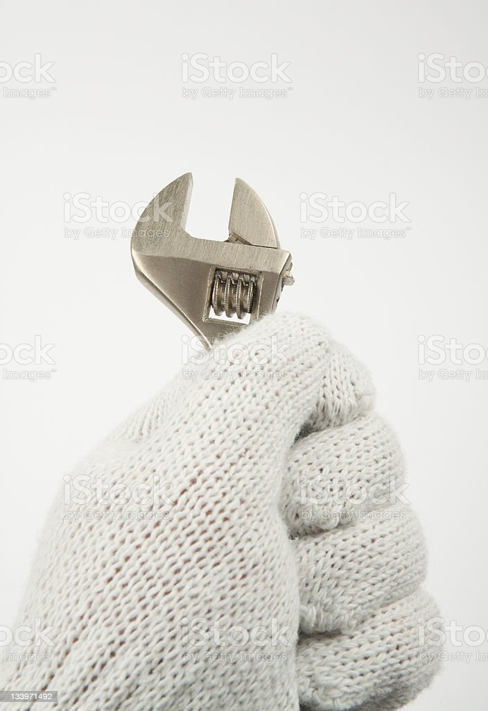 Wrench in hand royalty-free stock photo