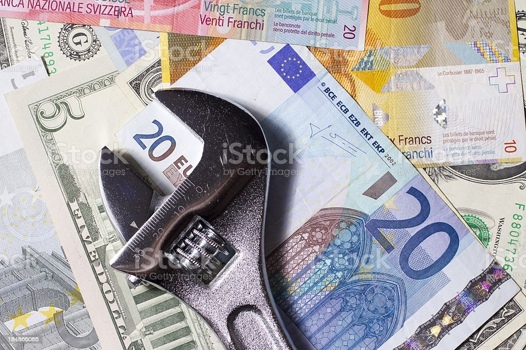 Wrench on money royalty-free stock photo