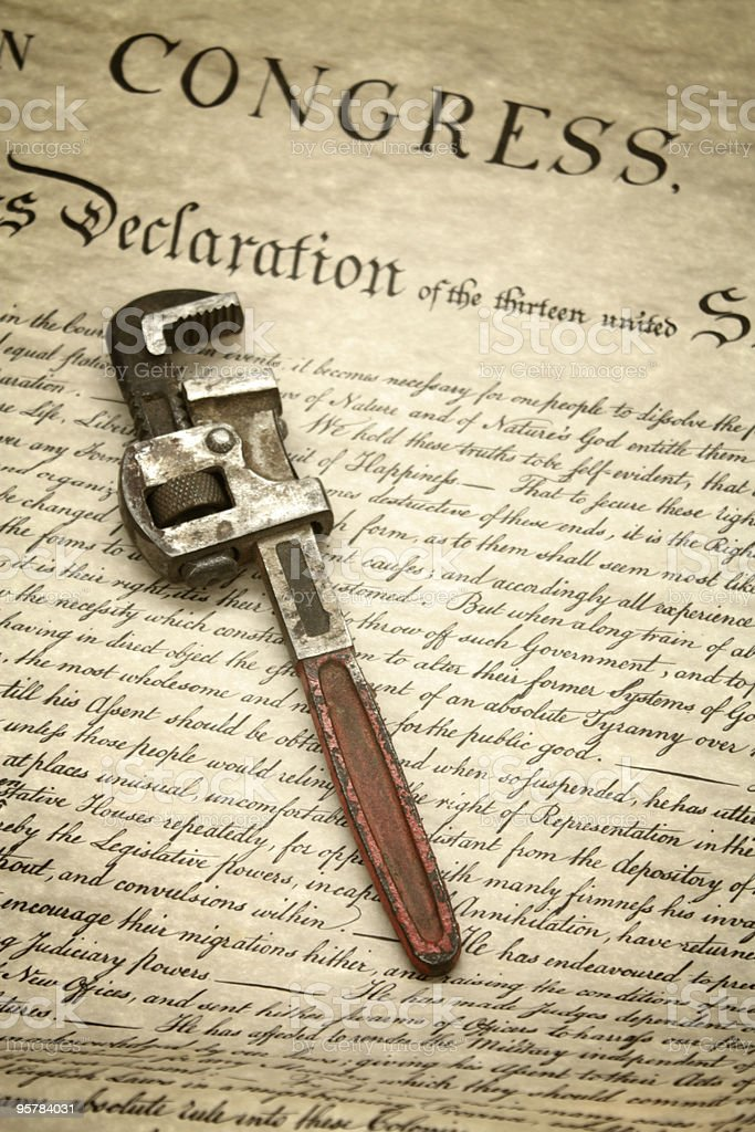Wrench on US Declaration of Independence royalty-free stock photo